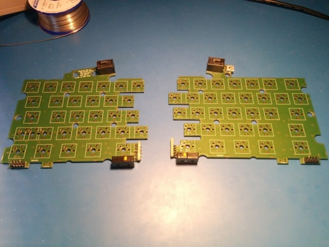 The depanelized PCBs with all the mechanical components (but the switches) soldered in